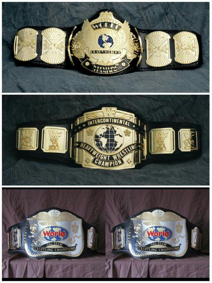 Championship Belts from the WWF (World Wrestling Federation Championship, Intercontinental Championship, Tag Team Championship)