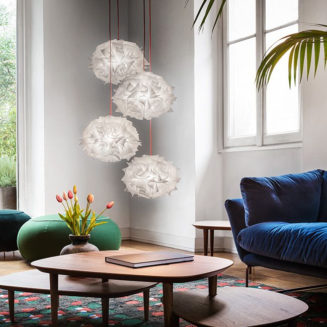 The Veli Mini Quartet Couture is a dramatic suspension lamp with a single, 32 cm canopy and four cascading spheres.