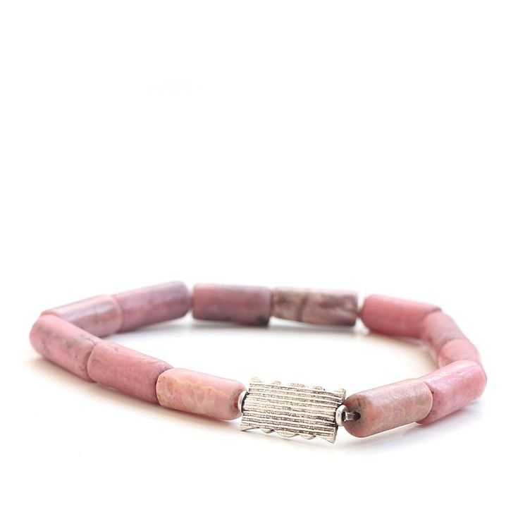 This understated bracelet will add mystery and sophistication to any outfit.Minku bracelets tell a story of travel and daring, and allude to an open mind. Each bracelet is strung from carefully selected materials for a contemporary, transcontinental appeal.The Digue bracelet is reminiscent of the pink-sand beaches of La Digue, one of the islands of the Seychelles, located off the East African coast.- .925 sterling silver bead with arabesque detail- flute-shaped rhodoni...