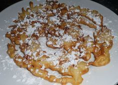 State Fair Funnel Cake Recipe: Easy recipe on how to make funnel cakes.