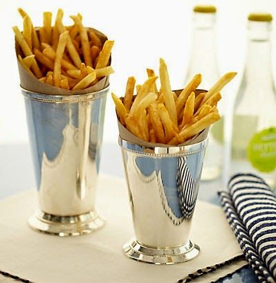 French Fries wrapped in brown paper and individual julep cups.