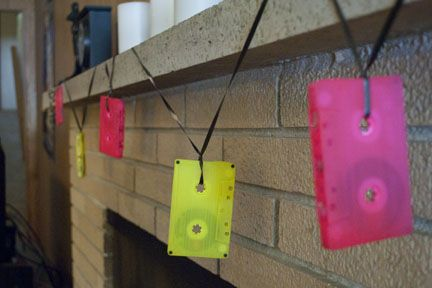Great 80's decor idea. Cassette tapes painted neon colors & hung as a garland. Hey, clip some LED lights on there as well!: http://www.flashingblinkylights.com/light-up-products/light-up-flashing-pins-body-lights/blinkies-round-leds.html