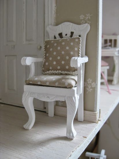 newly painted and upholstered chair with matching pillow in dollhouse parent´s bedroom