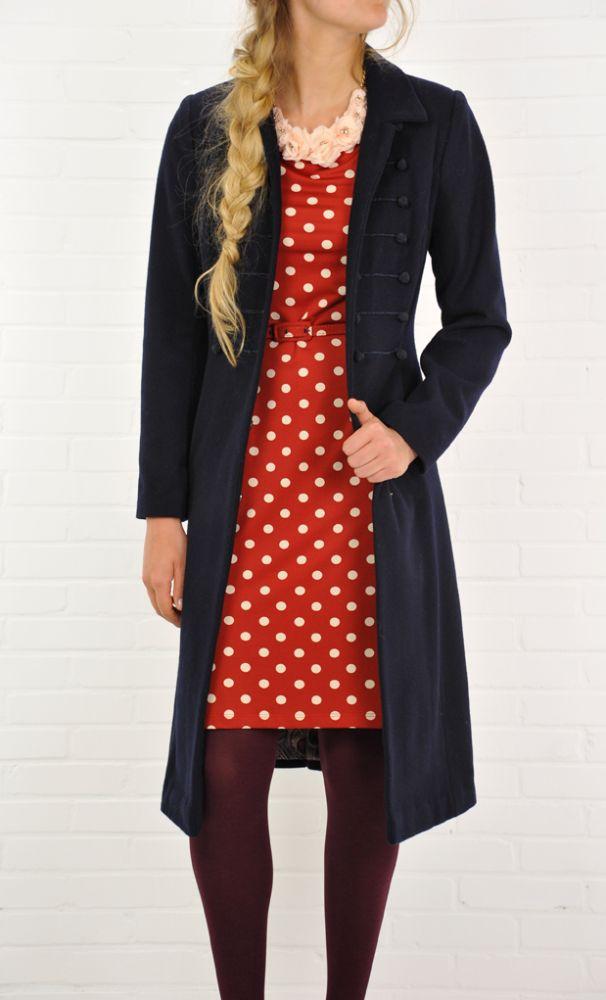 Model wears the Josie Coat with the Tulip Dress Belt Partypolka.