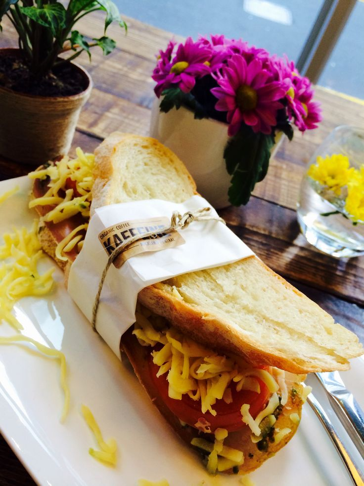 Breakfast or lunch. Try our most popular Italian Pesto Prosciutto sandwich today. #RealItalian #meltcheese #kaffeinenz