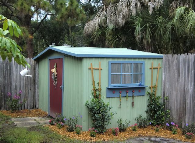Started as a basic white metal shed, she painted it, added trim, a window painted with Krylon Looking Glass Mirror-Like Paint, and a trellis for climbing plants