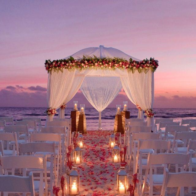 Gorgeous sunset beach wedding? I'm thinking so!!!! Maybe I should consider sunset...geez!