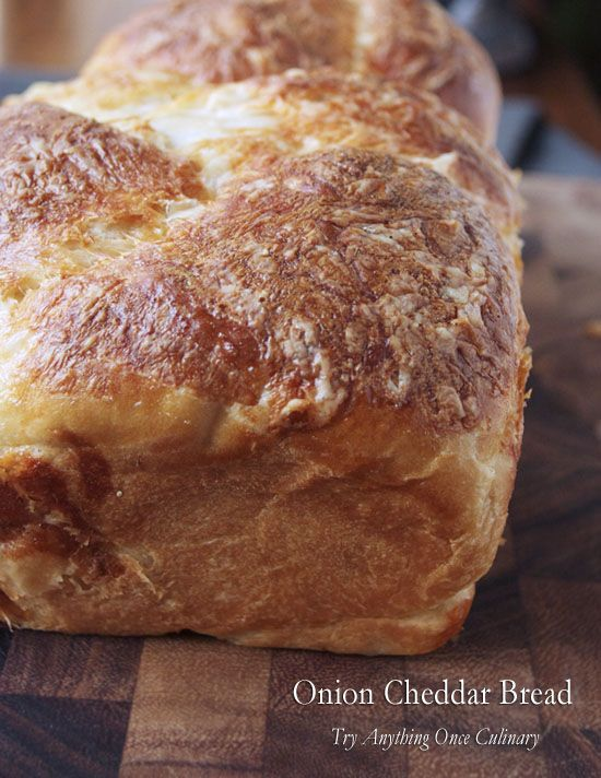 Caramelized onions and white cheddar make this onion cheddar bread a savory treat! This bread makes excellent sandwiches. #onion #cheddar #bread