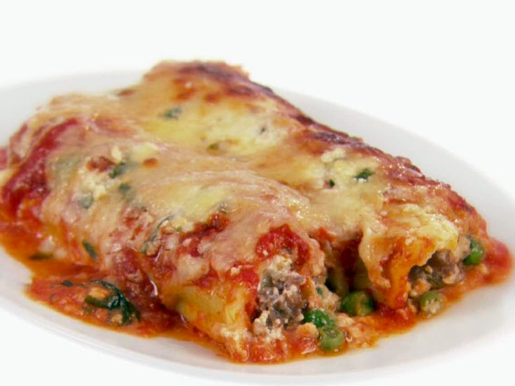 Food Network invites you to try this Baked Manicotti with Sausage and Peas recipe from Giada De Laurentiis.