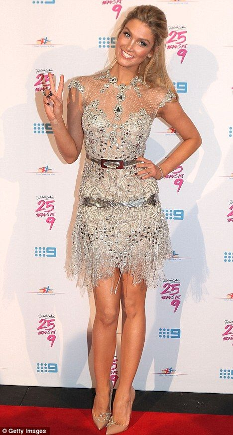 Delta Goodrem showed up to Richard Wilkins 25 Year Anniversary Fundraiser For Down Syndrome in Sydney yesterday looking stunning in a silver mini dress