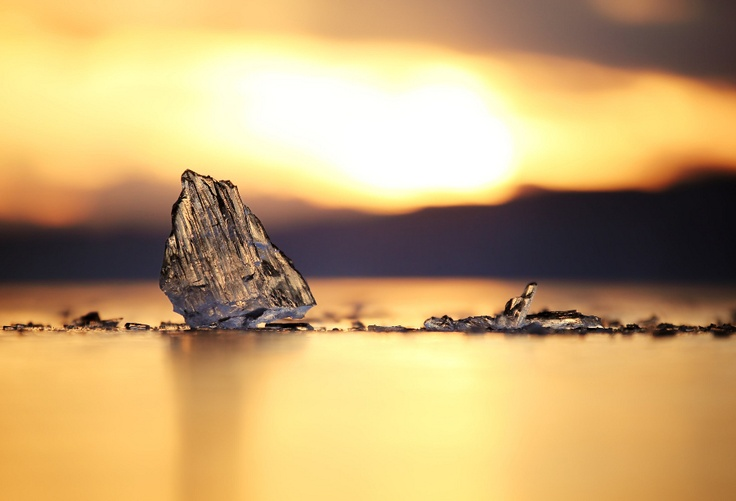 I was walking around Lake Baikal at sunset and spotted this ice. I laid on the cold, frozen surface with my zoom lens and took this picture.