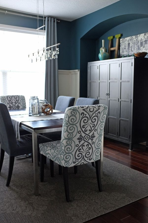 I love this dark blue paint color and the off-white wainscoting. Love the texture and fabric of the end chairs as well. Perfect compliment for my cherry dining room furniture.