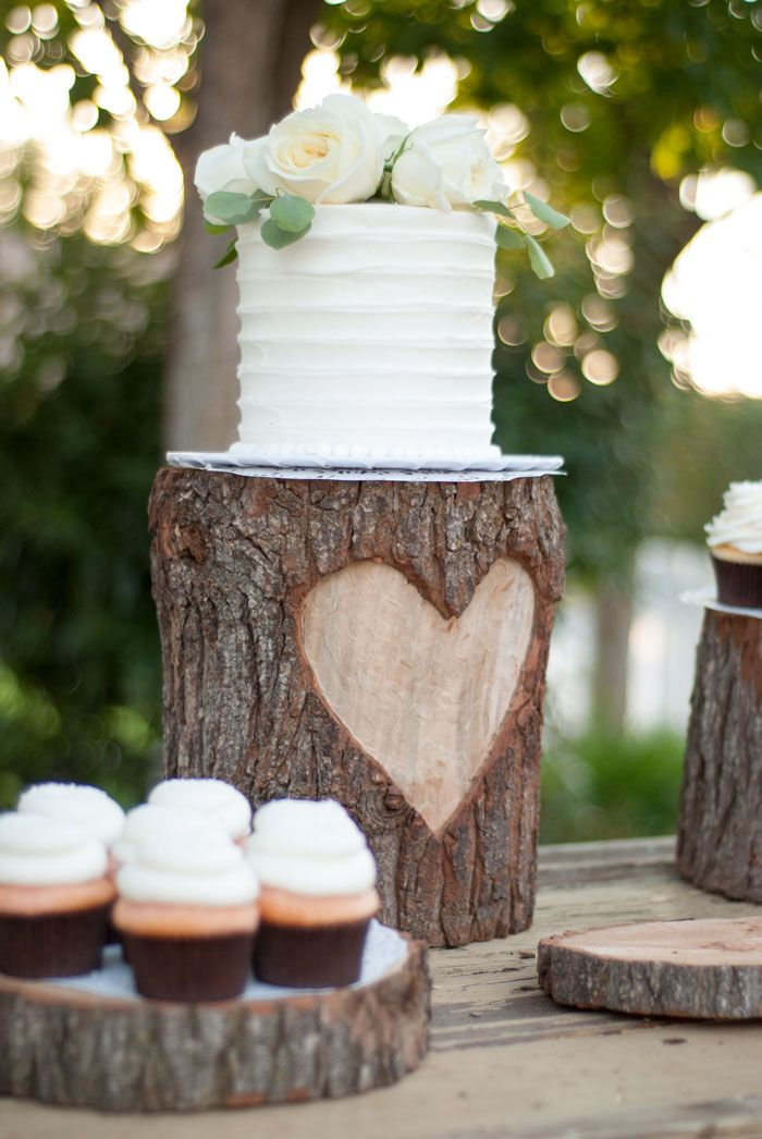 DIY HEART TREE STUMP WEDDING CAKE STAND TUTORIAL ... how to make a cupcake bar, cupcake bar ideas, wedding cake ideas, simple wedding cake, rose cake topper, wine barrel cake table, diy wedding cake, diy cake stand, woodsy country glam, heart tree stump cake stand, tree stump party display