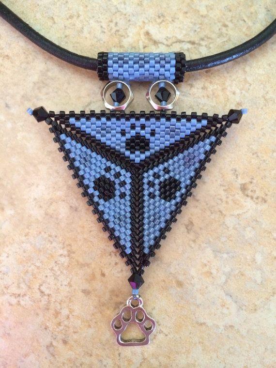 Paw print triangle necklace by BeadSplashHCJ on Etsy, $35.00
