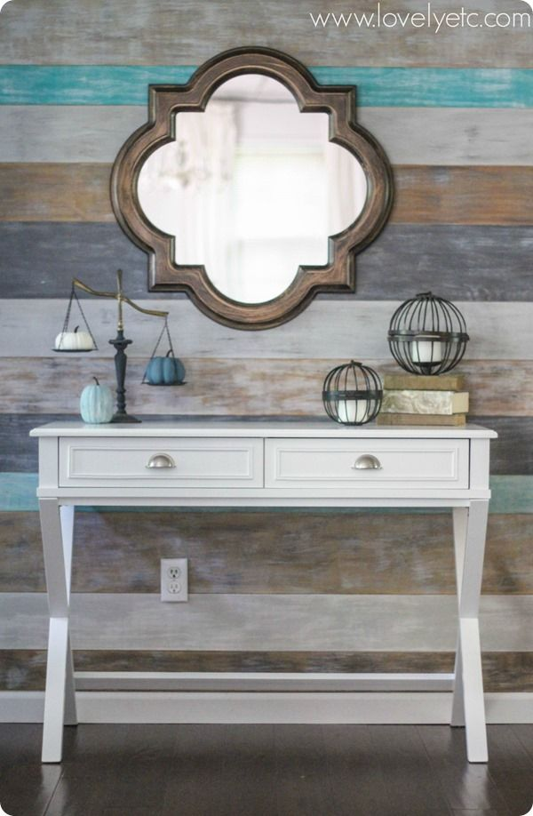 Looking to make your entry more inviting? A colorful plank wall, pretty mirror, and classic table combo keeps things beautiful and practical. @biglots #ICantEven #BigLots *ad