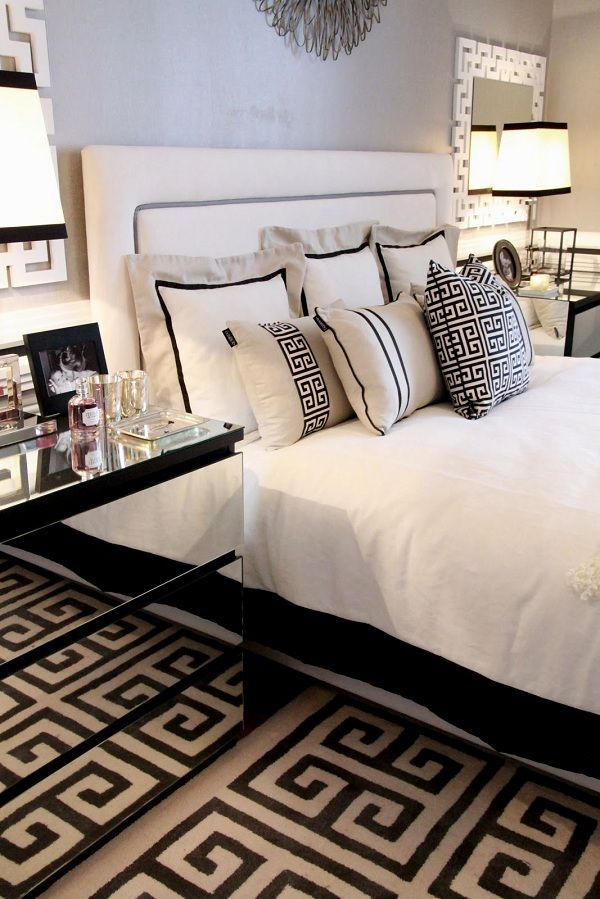 Black and white bedroom decor with mirrored modern nightstands with  storage. www.bocadolobo.