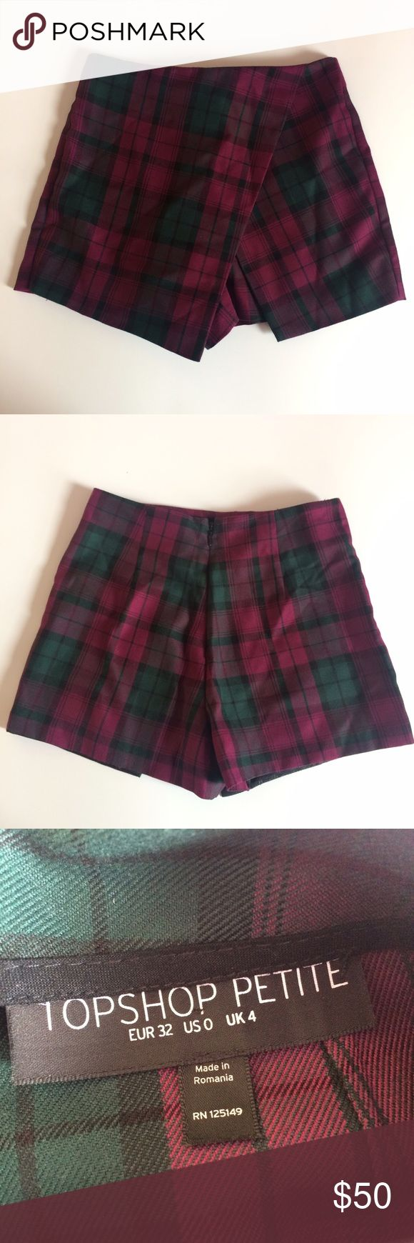 Topshop Petite Tartan Plaid Asymmetrical skort Topshop Petite size 0/XS asymmetrical tartan plaid skort. Bought at a Topshop store in the Philippines but only got to wear maybe twice. Orig. price was $58. Fits true to size. Like new condition, will iron before shipping. From a smoke-free, pet-free home. Feel free to ask questions or make an offer! 😊 Topshop Skirts Asymmetrical