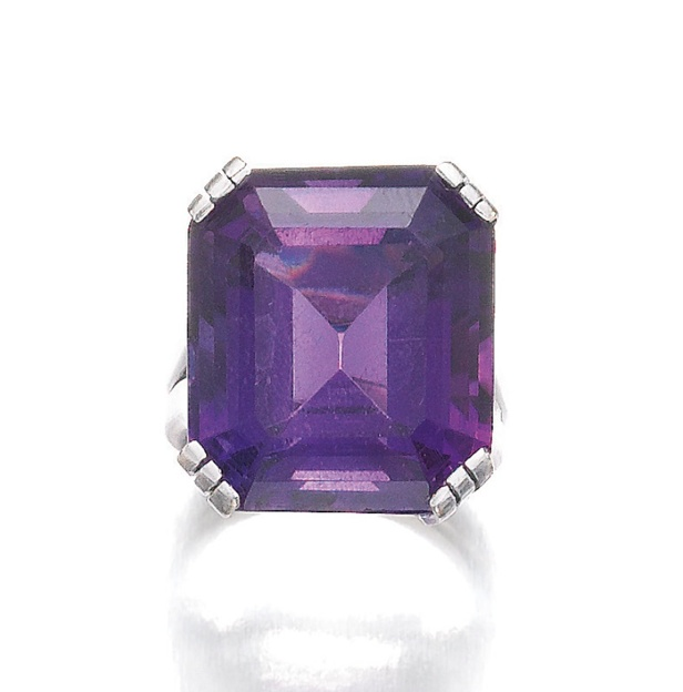 AMETHYST RING, SUZANNE BELPERRON, CIRCA 1970.  Set with a step-cut amethyst, size 50, French assay and maker's mark for Darde & Cie.