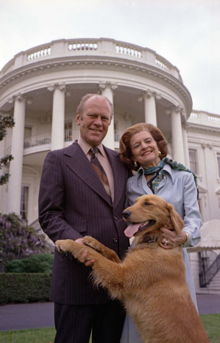 President and Mrs. Gerald R. Ford pose on the South Lawn of the White House with Liberty, their pet golden retriever. May 9, 1975.
