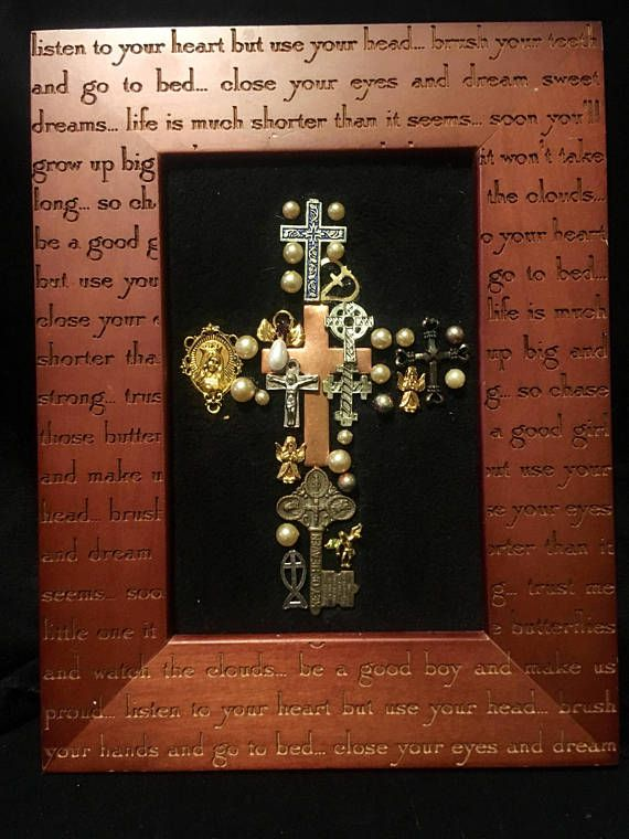 """This is a glorious piece of art- in a 9"""" x 6.75"""" wooden frame the center of the frame features a cross made of vintage to modern religious jewelry accents. An eclectic mix of crosses, angels and faux pearls. this is sure to brighten any area and create lots of joy searching through"""