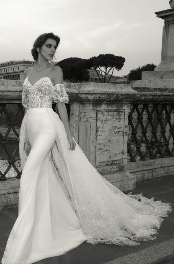 Featured Dress: Julie Vino; Off-the-shoulder overskirt wedding dress.
