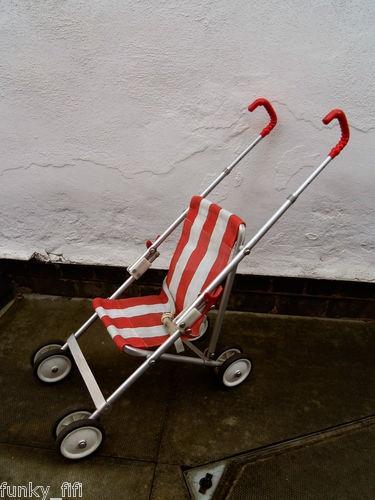 Red Maclaren doll's pushchair