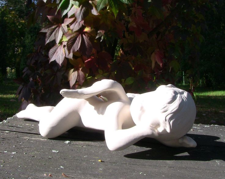 Ceramic sleeping angel is suitable for inside and outside uses. So simple but still beautiful element of decor.