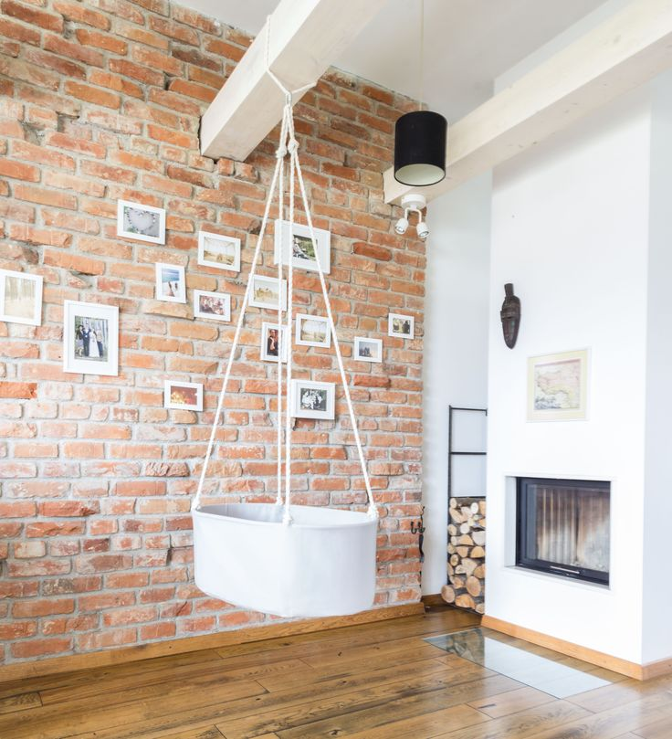 Natural oak floor, old rustic red bricks' wall, fireplace and pine wood beams - a perfect cozy place to suspend the Swingy Nest hanging baby cradle / bassinet!
