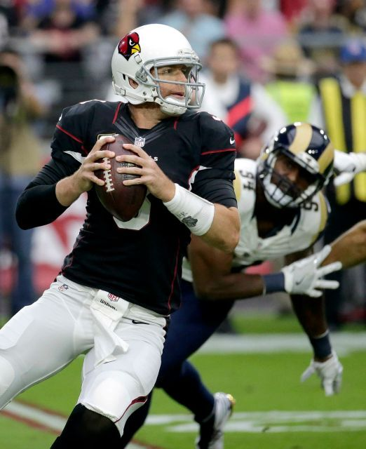 Rams vs. Cardinals Updated October 2, 2016:  17-13, Rams  -     Arizona Cardinals quarterback Carson Palmer (3) looks to throw as Los Angeles Rams defensive end Robert Quinn (94) pursues during the first half of an NFL football game, Sunday, Oct. 2, 2016, in Glendale, Ariz.