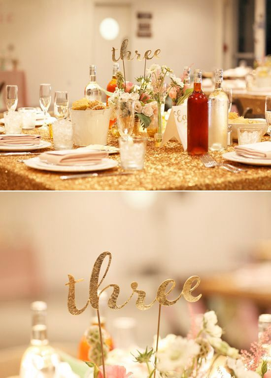 Table numbers. They look a little hard to see because they blend in with the flowers, but it is still a cute idea.
