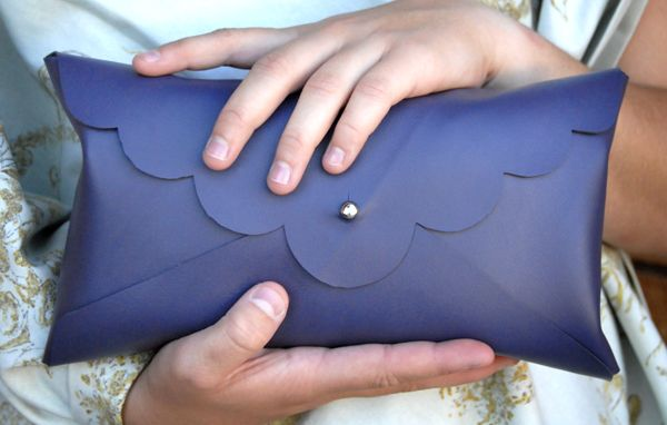 Easy No-Sew Clutch Tutorial. Can also be used to hold up to three size 4 diapers in your purse discreetly. So cute! Use your favorite fabric, leather or other material!