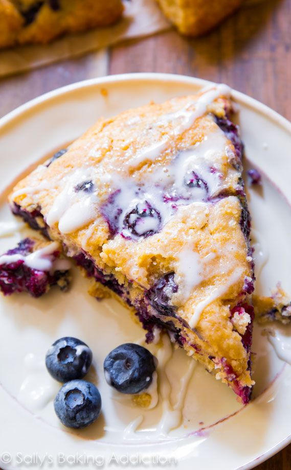 These simple Blueberry Scones are super moist and tender in every bite. Better than a bakery, trust me! sallysbakingaddiction.com