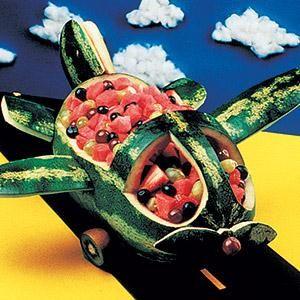 #Watermelon bowl/basket carving. Artie the Airplane. Art. Inspiration. Fruit Salad. Kiwi wheels. #Summer party. Children. Kids. Picnic ideas.