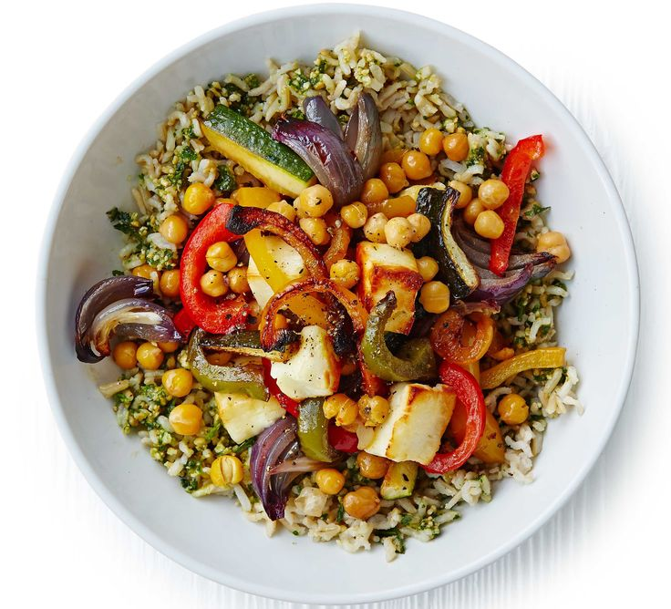 Stir parsley pesto through brown rice and top with onions, peppers, courgettes and chunks of halloumi cheese for a filling vegetarian dinner
