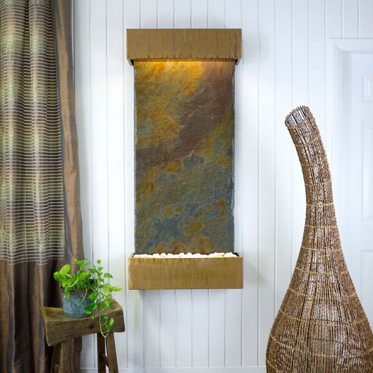 This Wall Fountain Features A Slab Of Natural Rajah Slate  Imbued With Warm,