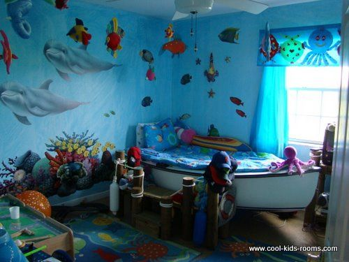 Under the Sea bedroom - A bedroom that has a bed as a boat shaped with blue bedding and some other elements that belong to sea and boating.