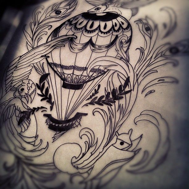 Classic hot air balloon tattoo - loving the vintage ink look. The lines are decently done. Not to much of a mess up.