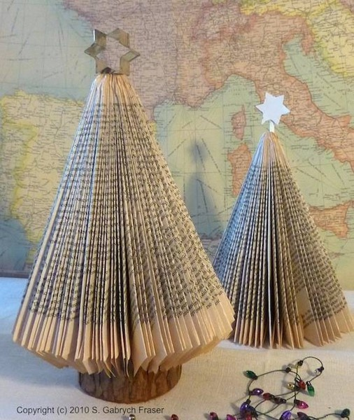 We made these year after year in Girl Scouts. spray paint green when you are done, then glue on sequins and voila, book christmas trees