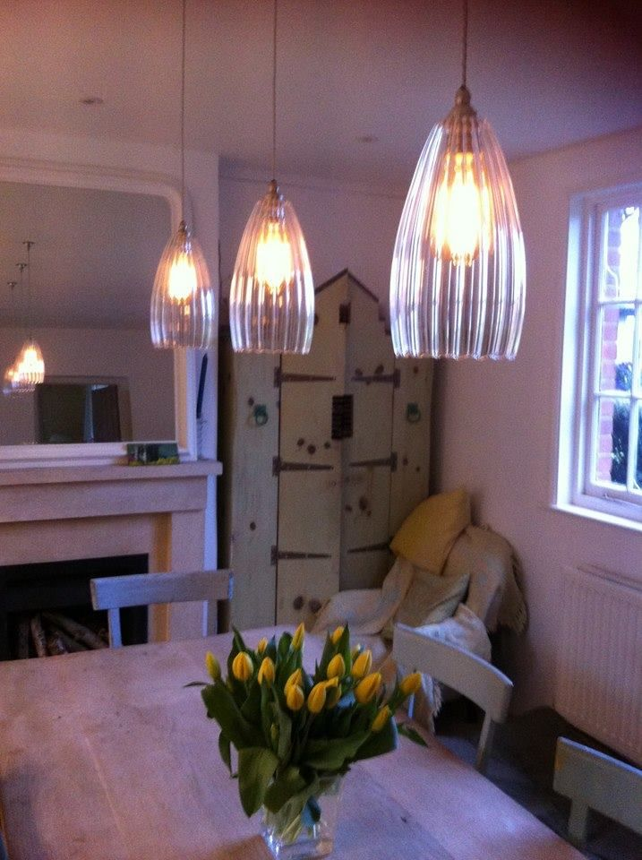 We recently received this lovely photo of our ribbed Upton pendant lights with LED tinted Edison Squirrel Cage Bulbs... Gorgeous! Thank you, Deborah, for sharing and for your very kind words.