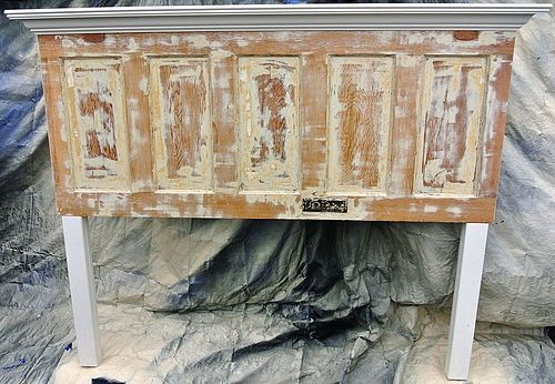 Distressed 85 year old door made into king size headboard