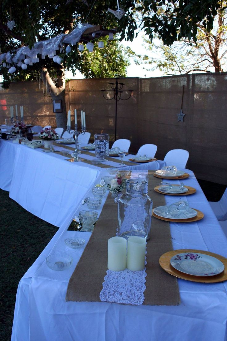 Large bridal table. Hessian & lace runners. Gold settings.