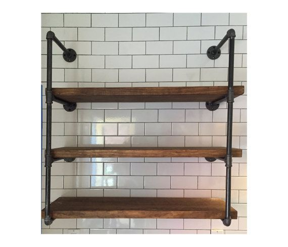 The newest industrial urban plumbing pipe decor. Great for lofts, office, commercial space, or anywhere that you want to install a true conversation piece. Designed to last a lifetime, Depth = 8 Width = 36 Height = Approximately 35 We clean the pipe and fittings, then we coat the item with a satin varnish to eliminate the continual dirt and soot from getting on your hands and clothes yet keep the gun metal color. We buy the wood from a sustainable mill, and is lightly sanded and mildly…