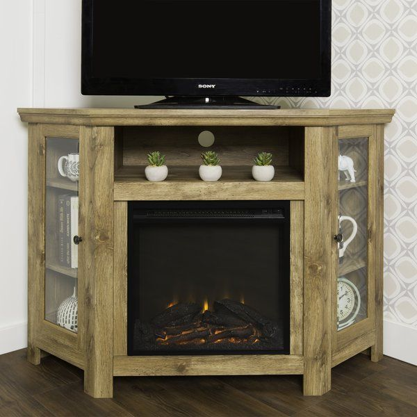 Utilize your corner space with this wood media stand with electric fireplace. Its corner design makes this the perfect space saving unit while creating a warm, entertaining space in your home. Crafted from high-grade MDF with a durable laminate finish. Features shelving behind two tempered glass doors, an open shelf to fit your media components and accessories, and a cable management system to maintain a tidy space. Installation requires no technician, simply plug into a standard household…