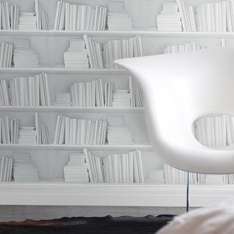 Look closely; this clever book-illusion wallpaper gives a bright, minimalist feel to homes that don't have the space for a contemporary designer bookshelf.