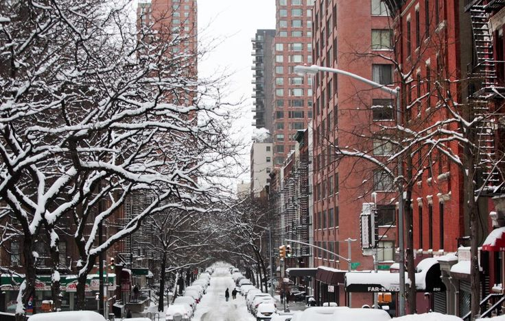 Passersby walk through an accumulation of snow on Jan. 27, 2015 on the Upper East Side of New York City. Snow levels from winter storm Juno in New York has ranged from 7.8 inches in Central Park to more than 28 inches in Eastern Long Island.