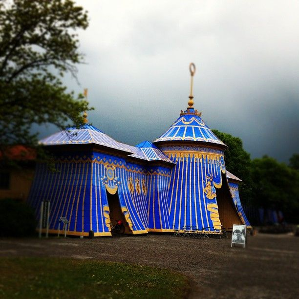 Colorful circus tent in a park by afiori.com, via Flickr