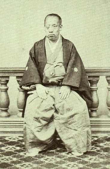"Japanese antique photograph. Tokugawa Yoshiyori (1828-1876). He is the present head of a household of the Tayasu Tokugawas. It was said, ""you resembled the Emperor Meiji in a face"" as for him. Therefore he said, ""it was dreadful"" and stung one's eyes with a sword. Edo era / Meiji era.徳川義頼(明治天皇にに似ていると言われ「それは恐ろしいことだ」と自ら剣で右目を刺したという)"