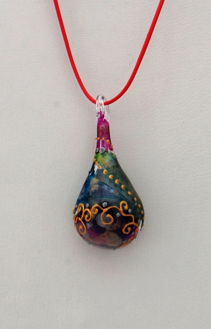 Hand painted glass pendant.
