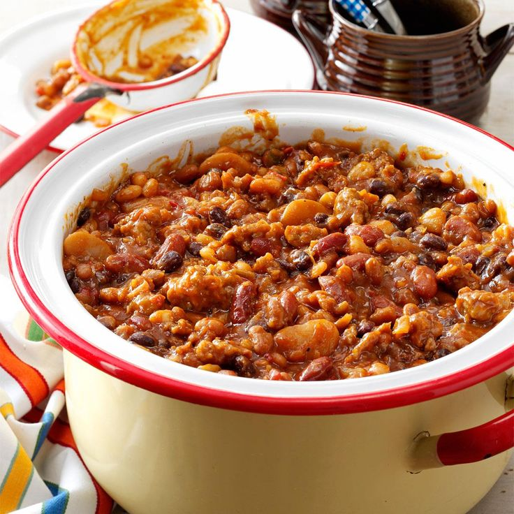 Smoky Baked Beans Recipe -They'll be standing in line for this saucy bean recipe, full of campfire flavor. A variation on colorful calico beans, it makes a great side dish with all your cookout favorites.—Lynne German, Cumming, Georgia