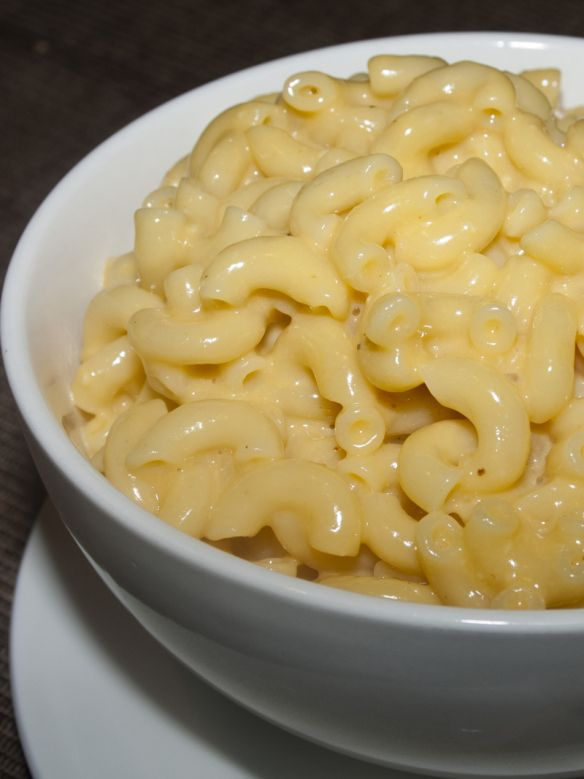 Alton Brown's Stove Top Macaroni & Cheese. skipped the mustard and hot sauce and used regular milk because i didn't have any evaporated. this was yummy. the texture was great. a little less salt next time.